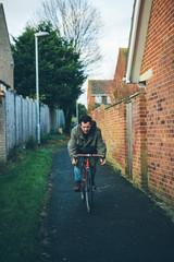 Man cycling in an alley