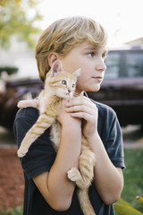Boy holding Kitten