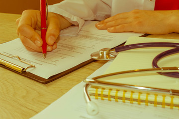 Doctor working in hospital writing a prescription. Medicine doct