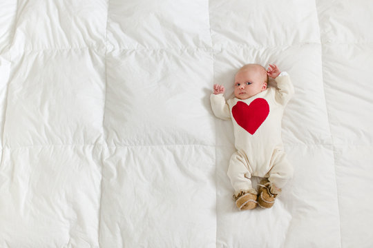 newborn in a heart onesie
