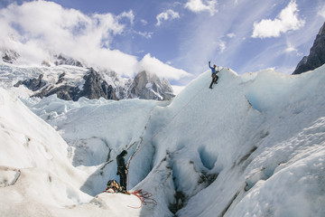 Man climbing on ice wall on a glacier in Patagonia, Argentina. Adventure sport