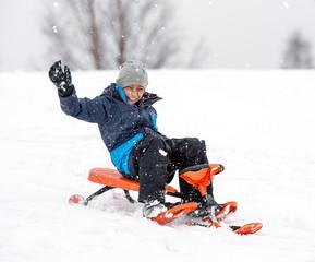 child having fun in the snow