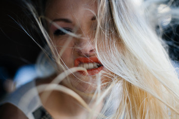 Beautiful Blond Woman with Hair Flowing/Flying
