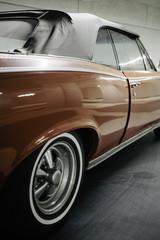 Close up of a classic red American car in a garage