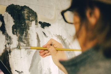 Woman Painting in a Workshop