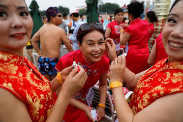 Participants get ready for the Third Grandbikini event to start in an aqua park in Tianjin