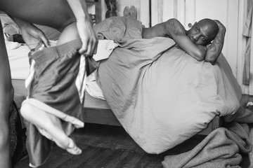 Black and White Photo of an Intimate Scene Between Two Gay Lovers in the Bedroom