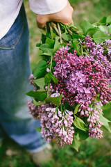 Woman holding lilac