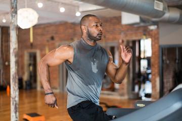 Muscular African-American man peforming an intense workout