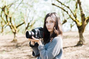 Girl shooting camera