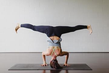A beautiful woman practicing yoga in a studio