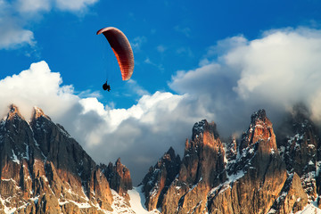 Fotobehang Luchtsport Paraglider flying near high mountains. Dolomites, Italy