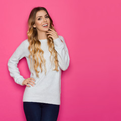 Beautiful Young Woman In Blue Pastel Sweater