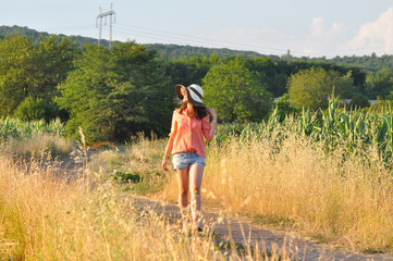 Beautiful Girl Alone Walking On The Country Road. Romantic Girl Traveling