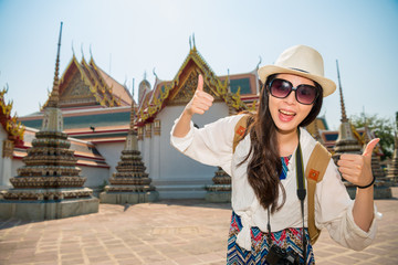 Happy tourist girl at wat pho of Thailand