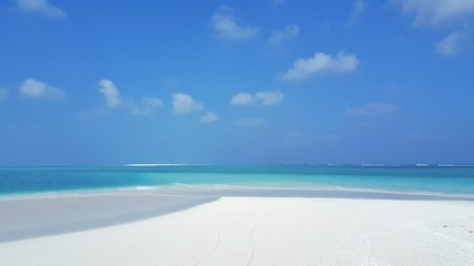 P00591 Maldives beautiful white sandy beach background on sunny tropical paradise island with aqua blue sky sea water ocean 4k