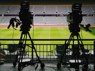 Dual video recording camera in a football stadium