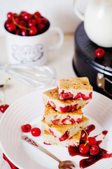 Cake, dessert and pastries, biscuit pie with cherry, raspberries and milk on a light background