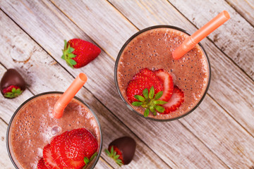 Chocolate strawberry smoothie. View from above, top studio shot