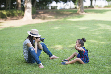 Mother taking pictures of her daughter