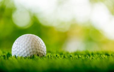 golf ball on green field