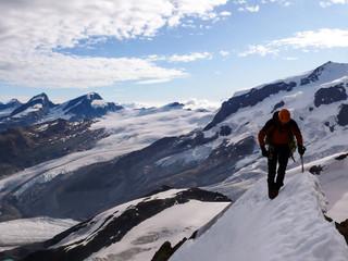 Foto op Aluminium Alpinisme single male climber free solo on an exposed snowy ridge on a north face route in the Swiss Alps near Zermatt