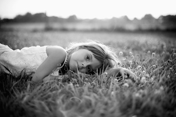 Girl Laying In a Field Of Clover On A Summer Evening