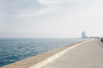 Scenic view of the sea and the breakwater of a mediterranean city