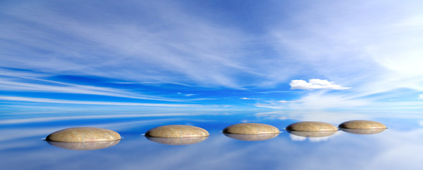 Zen stones on a blue sky and sea background. 3d illustration