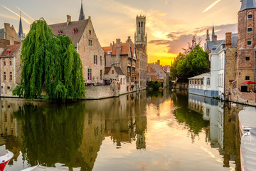 Papiers peints Bruges Bruges (Brugge) cityscape with water canal at sunset