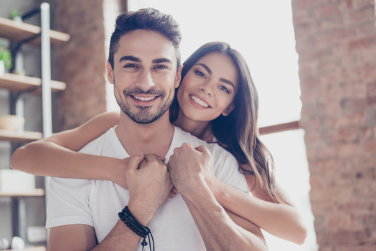 True love. Beautiful latino mulatto couple of young lovers are hugging indoors at home, with love and tenderness, wearing casual clothes