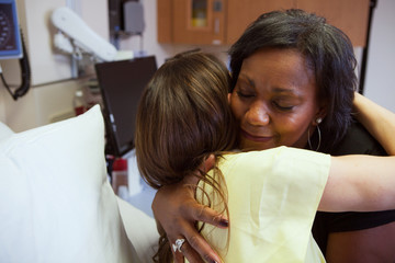 Hospital: Patient Receives Hug During Visit From Friend