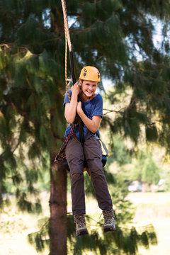 girl on a zip line adventure swing