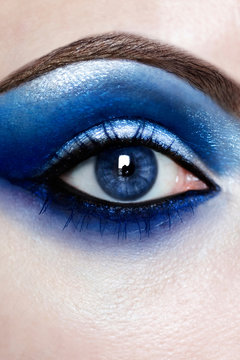 Close up view of right eye with blue eyeshadow