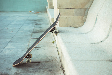 Skateboard leaning against a bench