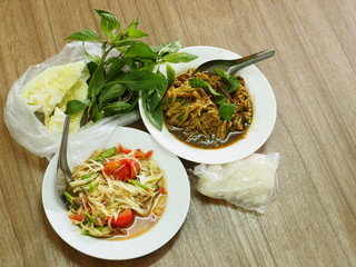 Thai food Papayaand Spicy shredded bamboo shoot salad with vegetable and sticky rice