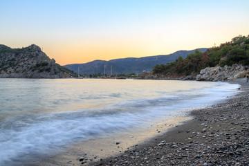 Kizilca buk beach and mesutiye during sunset in Datca, Turkey