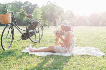 Woman sitting on a picnic rug