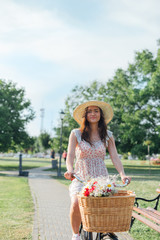 Woman in a park with a basket of flowers