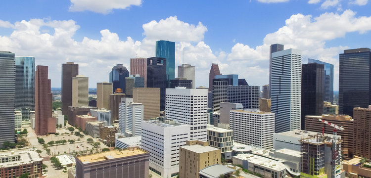 Panorama aerial view Houston downtown against cloud blue sky with empty parking lot at weekends, building/high-rises under construction and background of skyscrapers in the business district area