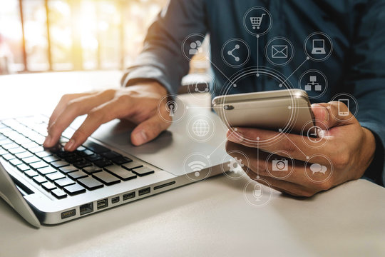 close up of hand using tablet ,laptop, and holding credit card online banking payment communication network,internet wireless application development sync app,virtual graphic  icon diagram