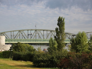 Railroad Bridge in Vienna with Grass and Trees in Foreground