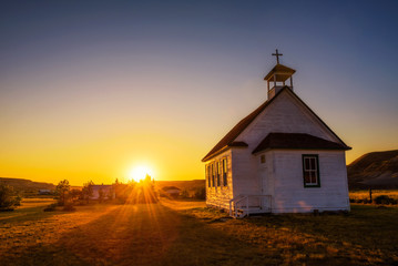 Photo sur Aluminium Edifice religieux Sunset over the old church in the ghost town of Dorothy