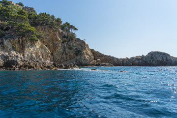 View from the sea on a beautiful rocky landscape on a sunny day