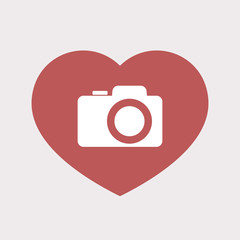 Isolated heart with a photo camera