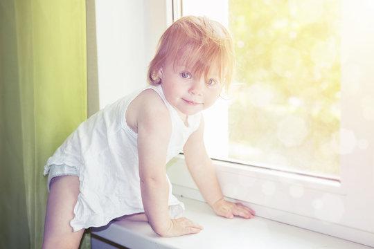 child on window