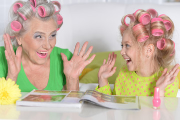 woman and granddaughter doing make up