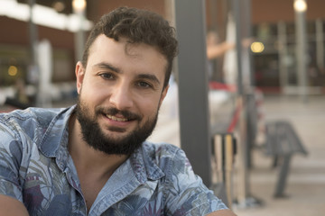 35 years old man looking at camera in restaurant terrace