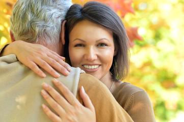 woman and senior man hugging