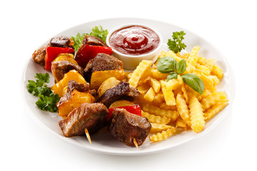 Shashlik - grilled meat and vegetables on white background